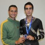 Edoardo e Ivan esibiscono lo scudetto di Campione d'Italia A.I.C.S. 2010 conquistato a Misano.